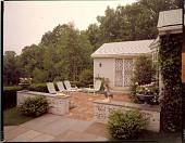 view [Iaccaci Garden]: house and patios, looking out toward woods. digital asset: [Iaccaci Garden] [film transparency]: house and patios, looking out toward woods.