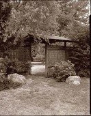 view [Miles Garden]: bamboo-roofed gatehouse. digital asset: [Miles Garden] [safety film negative and photographic print]: bamboo-roofed gatehouse.