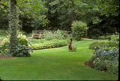 view [Gannett Garden]: perennial beds with wide mown area and metal goose in center. digital asset: [Gannett Garden]: perennial beds with wide mown area and metal goose in center.: 2004 Sep.