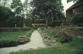 view [Olsen Garden]: gravel pathway and garden border. digital asset: [Olsen Garden]: gravel pathway and garden border.: 2005 May.