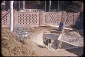 view [Phillips Garden]: construction of pool at center, brick wall (completed) in background. digital asset: [Phillips Garden] [slide (photograph)]: construction of pool at center, brick wall (completed) in background.