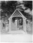 view Kilkhampton Church: looking toward the church through the lych gate. digital asset: Kilkhampton Church [glass negative]: looking toward the church through the lych gate.