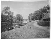 view [Nuneham House and Park]: the River Thames near Nuneham Park Bridge, with part of a thatched cottage visible on the right. digital asset: [Nuneham House and Park] [glass negative]: the River Thames near Nuneham Park Bridge, with part of a thatched cottage visible on the right.