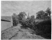 view [Miscellaneous Sites in Shere, Surrey, England, and Vicinity, Series 1]: looking along the River Tillingbourne toward the Church of St. James. digital asset: [Miscellaneous Sites in Shere, Surrey, England, and Vicinity, Series 1] [glass negative]: looking along the River Tillingbourne toward the Church of St. James.