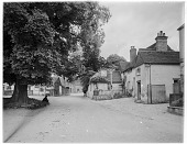 view [Miscellaneous Sites in Shere, Surrey, England, and Vicinity, Series 1]: looking toward the White Horse pub (on the right) in The Square at Shere. digital asset: [Miscellaneous Sites in Shere, Surrey, England, and Vicinity, Series 1] [glass negative]: looking toward the White Horse pub (on the right) in The Square at Shere.