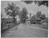 view [Miscellaneous Sites in Shere, Surrey, England, and Vicinity, Series 2]: Gomshall Lane in Shere, with what is now the Shere Church of England Infant School on the left. digital asset: [Miscellaneous Sites in Shere, Surrey, England, and Vicinity, Series 2] [glass negative]: Gomshall Lane in Shere, with what is now the Shere Church of England Infant School on the left.