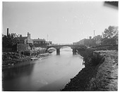 view [Miscellaneous Sites in West Sussex, England]: the old bridge over the River Arun in Arundel with the ivy-covered Bridge Hotel visible on the left. digital asset: [Miscellaneous Sites in West Sussex, England] [glass negative]: the old bridge over the River Arun in Arundel with the ivy-covered Bridge Hotel visible on the left.