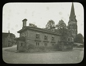 view [Chatsworth Estate]: the Edensor schoolhouse (built 1841; demolished 1950) with St. Peter's Church in the background. digital asset: [Chatsworth Estate] [lantern slide]: the Edensor schoolhouse (built 1841; demolished 1950) with St. Peter's Church in the background.