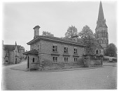 view [Chatsworth Estate]: the Edensor schoolhouse (built 1841; demolished 1950) with St. Peter's Church in the background. digital asset: [Chatsworth Estate] [glass negative]: the Edensor schoolhouse (built 1841; demolished 1950) with St. Peter's Church in the background.
