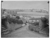 view [Miscellaneous Sites in Branscombe, Devon, England]: looking down toward the Masons Arms Hotel. digital asset: [Miscellaneous Sites in Branscombe, Devon, England] [glass negative]: looking down toward the Masons Arms Hotel.