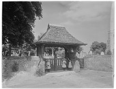 view [Miscellaneous Sites in Sussex, England, Series 1]: the lych gate and cemetery of St. Andrew's Church in Steyning, West Sussex. digital asset: [Miscellaneous Sites in Sussex, England, Series 1] [glass negative]: the lych gate and cemetery of St. Andrew's Church in Steyning, West Sussex.