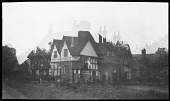 view [Eaton Hall]: a double exposure with one image being of a house on School Lane in the Eaton Hall estate village of Aldford, Cheshire. digital asset: [Eaton Hall] [negative]: a double exposure with one image being of a house on School Lane in the Eaton Hall estate village of Aldford, Cheshire.