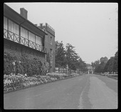 view [Hampton Court Palace]:  looking along a garden border toward the famous Flower Pot Gates. digital asset: [Hampton Court Palace] [lantern slide]: looking along a garden border toward the famous Flower Pot Gates.