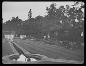 view [Esher Place]: the sunken garden, designed by Sir Edwin Lutyens, with its distinctive rill or Edwardian canal. digital asset: [Esher Place] [lantern slide]: the sunken garden, designed by Sir Edwin Lutyens, with its distinctive rill or Edwardian canal.