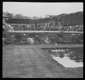 view [Unidentified Location]: a terraced garden with stone retaining walls and a lily pond in an unidentified location. digital asset: [Unidentified Location] [lantern slide]: a terraced garden with stone retaining walls and a lily pond in an unidentified location.