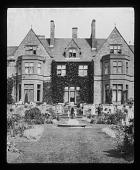 view [Abbotswood]: house, garden, and sculptural sundial. digital asset: [Abbotswood] [lantern slide]: house, garden, and sculptural sundial.