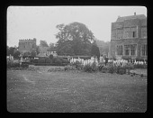 view [Broughton Castle]: the gardens, with the castle on the right and the gatehouse in the left background. digital asset: [Broughton Castle] [lantern slide]: the gardens, with the castle on the right and the gatehouse in the left background.