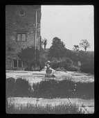 view [Tower Close]: a portion of the garden and a corner of the house. digital asset: [Tower Close] [lantern slide]: a portion of the garden and a corner of the house.
