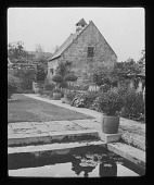 view [Snowshill Manor]: an outbuilding with dovecote cupola and part of the garden at Snowshill Manor. digital asset: [Snowshill Manor] [lantern slide]: an outbuilding with dovecote cupola and part of the garden at Snowshill Manor.