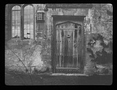 view [Notgrove Manor]: an old, weathered Tudor door. digital asset: [Notgrove Manor] [lantern slide]: an old, weathered Tudor door.