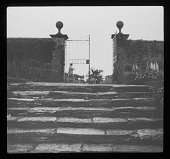 view [Notgrove Manor]: tough-hewn stone stairs and gate in the garden. digital asset: [Notgrove Manor] [lantern slide]: rough-hewn stone stairs and gate in the garden.