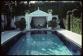 view [Dayton Garden]: tiles from Valencia, Spain create the appearance of an oriental rug on the bottom of the pool. digital asset: [Dayton Garden]: tiles from Valencia, Spain create the appearance of an oriental rug on the bottom of the pool.: 1996 Mar.