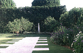 view [Untitled Garden in Palm Beach, Florida]: walk beyond entry with view of fruit trees and obelisk. digital asset: [Untitled Garden in Palm Beach, Florida]: walk beyond entry with view of fruit trees and obelisk.: 2000 May.