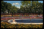view [Gerbing Gardens]: colorized photo postcard depicting the sunken pool and fountain as it was inthe 1940's, framed in marigolds and azaleas. digital asset: [Gerbing Gardens]: colorized photo postcard depicting the sunken pool and fountain as it was inthe 1940's, framed in marigolds and azaleas.: 1945-1947.