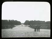 view [Fontainebleau]: part of the formal garden of the château, with the Grand Canal barely visible in the distance. digital asset: [Fontainebleau]: part of the formal garden of the château, with the Grand Canal barely visible in the distance.: [between 1914 and 1925]