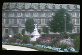 view [Tuileries Garden]: part of the garden with the Pavillon de Marsan in the background. digital asset: [Tuileries Garden]: part of the garden with the Pavillon de Marsan in the background.: [between 1900 and 1930]