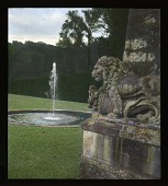 view [Château de Vaux-le-Vicomte]: lion sculpture and fountain adjacent to the grottos at the far end of the perspective from the château. digital asset: [Château de Vaux-le-Vicomte]: lion sculpture and fountain adjacent to the grottos at the far end of the perspective from the château.: 1936 Jun.