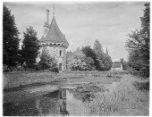 view [Chateau de Saint-Germain-de-Livet]: part of the chateau and its moat, with the steeple of the Eglise Saint-Jean visible in the background. digital asset: [Chateau de Saint-Germain-de-Livet] [glass negative]: part of the chateau and its moat, with the steeple of the Eglise Saint-Jean visible in the background.