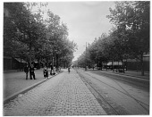 view [Miscellaneous Sites in France, Series 1]: an unidentified streetscape with rail or trolley tracks, probably in Paris. digital asset: [Miscellaneous Sites in France, Series 1] [glass negative]: an unidentified streetscape with rail or trolley tracks, probably in Paris.