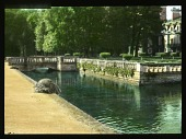view [Château de Courances]: looking across a moat-like water feature, with the château and its parterre garden visible on the right. digital asset: [Château de Courances]: looking across a moat-like water feature, with the château and its parterre garden visible on the right.: 1936 Jul.