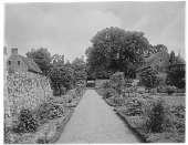 view [Manoir d'Archelles and Vicinity]: the walled garden, with the manor house on the right and gatehouse on the left. digital asset: [Manoir d'Archelles and Vicinity] [glass negative]: the walled garden, with the manor house on the right and gatehouse on the left.
