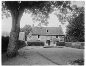 view [Manoir d'Archelles and Vicinity]: the gatehouse seen from the manor house. digital asset: [Manoir d'Archelles and Vicinity] [glass negative]: the gatehouse seen from the manor house.