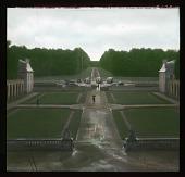 view [Château de Champs-sur-Marne]: main entrance courtyard and walkway, with parking area in the background. digital asset: [Château de Champs-sur-Marne]: main entrance courtyard and walkway, with parking area in the background.: 1936 Jul.