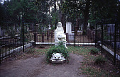 """view [Bonaventure Cemetery]: cemetery view, showing """"Little Gracie,"""" by John Wolz. digital asset: [Bonaventure Cemetery]: cemetery view, showing """"Little Gracie,"""" by John Wolz.: 1999 May."""