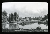 view [Unidentified landscape]: a ring of trees encircling a structure on a small island; a large building in the distance; people and a horse-drawn wagon loaded with hay in the foreground. digital asset: [Unidentified landscape]: a ring of trees encircling a structure on a small island; a large building in the distance; people and a horse-drawn wagon loaded with hay in the foreground.: [between 1914 and 1949?]