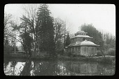 view [Unidentified landscape]: an ornately ornamented tiered and curved roof building beside a body of water. digital asset: [Unidentified landscape]: an ornately ornamented tiered and curved roof building beside a body of water.: [between 1914 and 1949?]