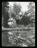 view [Versailles]: a pond and thatched roof house in the Hameau de la Reine, Marie Antoinette's rustic, faux country village in the Versailles park. digital asset: [Versailles]: a pond and thatched roof house in the Hameau de la Reine, Marie Antoinette's rustic, faux country village in the Versailles park.: [between 1914 and 1949]