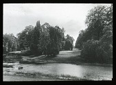 view [Unidentified landscape]: trees, lawn, and body of water; a steeple in the distance. digital asset: [Unidentified landscape]: trees, lawn, and body of water; a steeple in the distance.: [between 1914 and 1949?]