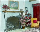 view [Miscellaneous Flower Arrangements]: flower arrangements by a fireplace. digital asset: [Miscellaneous Flower Arrangements]: flower arrangements by a fireplace.: [between 1914 and 1949?]