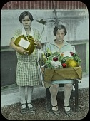 view [School Garden Exhibitions]: two young women with a pumpkin and an arrangement of vegetables. digital asset: [School Garden Exhibitions]: two young women with a pumpkin and an arrangement of vegetables.: [between 1914 and 1949?]