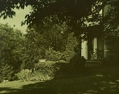 view [Unidentified Garden in Unidentified Location]: lawn in shade by house with semicircular porch, columns, chairs, and irises. digital asset: [Unidentified Garden in Unidentified Location] [lantern slide]: lawn in shade by house with semicircular porch, columns, chairs, and irises.