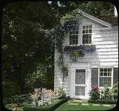 view Pullman Garden: doorway of guesthouse; spring bloom borders. digital asset: Pullman Garden: doorway of guesthouse; spring bloom borders.: [between 1926 and 1949?]
