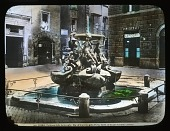 view Fontana delle Tartarughe: the fountain and surrounding buildings in the Piazza Mattei. digital asset: Fontana delle Tartarughe: the fountain and surrounding buildings in the Piazza Mattei.: [between 1900 and 1930]