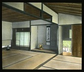view [Miscellaneous Sites in Japan]: an interior at an unidentified location, possibly the Tenryu-ji Monastery in Kyoto, showing tatami mats, ikebana, pottery, and a scroll, with a glimpse of the outdoors. digital asset: [Miscellaneous Sites in Japan]: an interior at an unidentified location, possibly the Tenryu-ji Monastery in Kyoto, showing tatami mats, ikebana, pottery, and a scroll, with a glimpse of the outdoors.: 1935 May.
