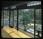 view [Miscellaneous Sites in Japan]: looking from a porch or pavilion across a pond garden in an unidentified location. digital asset: [Miscellaneous Sites in Japan]: looking from a porch or pavilion across a pond garden in an unidentified location.: 1935 May.