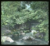 view [Miscellaneous Sites in Japan]: a small waterfall in a garden in an unidentified location. digital asset: [Miscellaneous Sites in Japan]: a small waterfall in a garden in an unidentified location.: 1935 May.